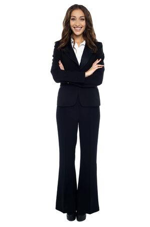Full length shot of confident smiling businesswoman over white background. Stock Photo - 17489943