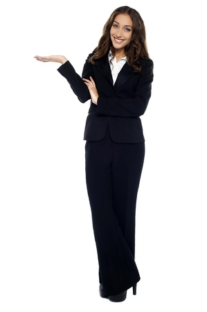 scheduled: Pretty receptionist welcoming business guests just before scheduled meeting. Stock Photo