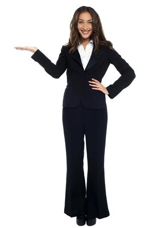 Portrait of beautiful corporate female presenting copy space area. Stock Photo - 17489951