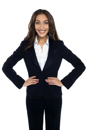 Charming corporate woman resting her hands on waist and smiling heartily. Stock Photo - 17490108