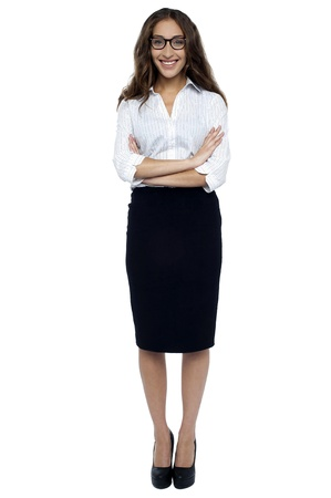 Bespectacled business executive in formals with with arms crossed, full length portrait. photo