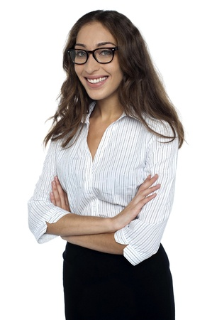 Portrait of a happy young businesswoman standing with folded hands against white background. Stock Photo - 17490090