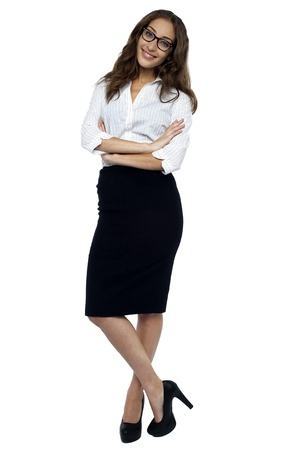 attire: Smiling businesswoman isolated over white background. Stock Photo