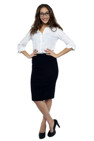 Pretty business professional posing in style with hands on her waist, wearing stilettos. Stock Photo - 17490342