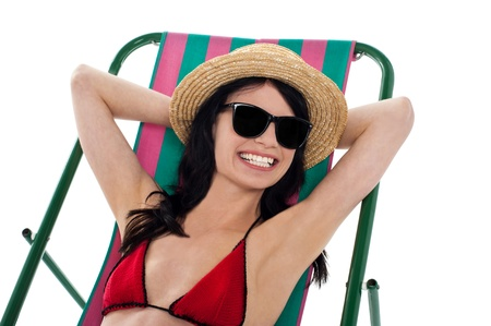 Sexy bikini model in dark shades chilling out and enjoying vacations. Stock Photo - 17560787