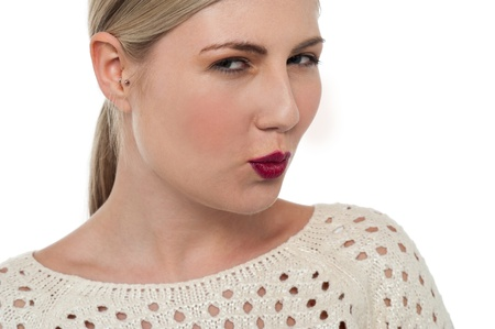 Beautiful teenage blonde with bright red lipstick shade is ready to kiss. photo