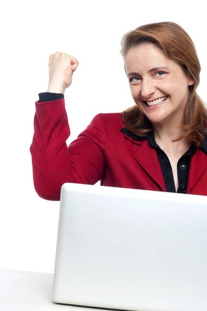 Cropped image of an excited businesswoman celebrating her success. photo