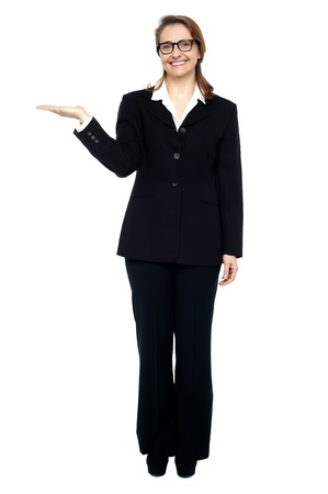 Full length shot of corporate lady in business suit. Copy space concept. photo