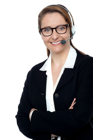 Lady with microphone headset on ready to assist you. Posing confidently with folded arms. photo
