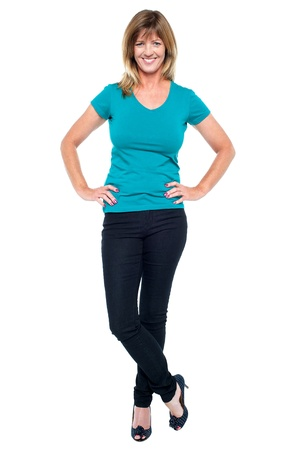 women in jeans: Full length portrait of an elegant blonde lady with hands on waist. Stock Photo