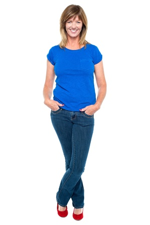 middle aged: Full length portrait of a middle aged woman in trendy outfit striking stylish pose.