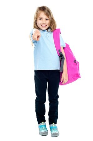 Cheerful pretty kid pointing towards you. Isolated over white. Stock Photo - 17750980