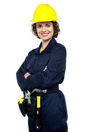 Smiling female engineer posing confidently. photo