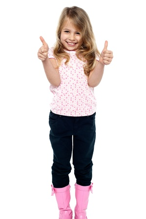 Cheerful young caucasian girl showing double thumbs up to the camera. Stock Photo - 17750981