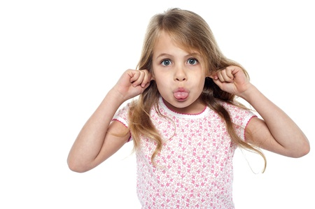 punishments: Young girl child making faces pulling her ears and jutting out her tongue.