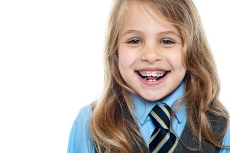 cute braces: Pretty elementary school girl posing cheerfully. Closeup shot.