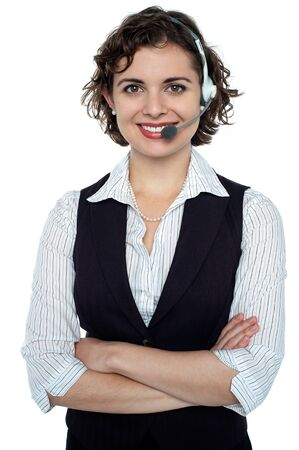 Cheerful young executive with headphones on posing confidently. Stock Photo - 17959380
