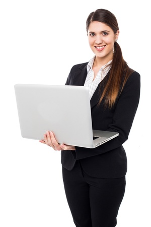 Attractive corporate woman working on laptop. Stock Photo - 17988854