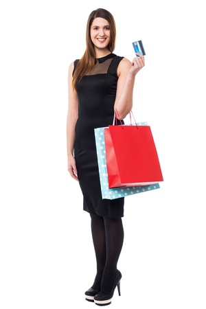 Full length portrait of an attractive woman posing with shopping bags and credit card. Stock Photo - 17988833
