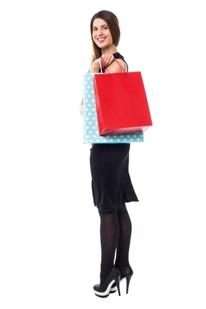Stylish young woman with bright shopping bags, full length studio shot. Stock Photo - 17988818