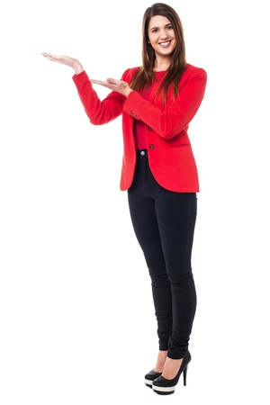 Full length shot of an elegant young woman presenting something. Stock Photo - 17988831
