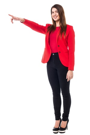 Full length portrait of a young female pointing towards different direction. Stock Photo - 18021421
