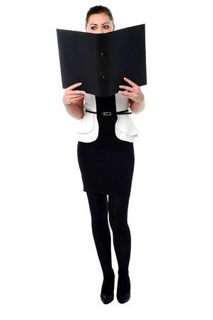Full length portrait of a stylish corporate woman with a file. photo