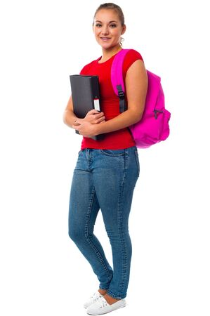 assignment: Beautiful university girl with backpack and assignment file.