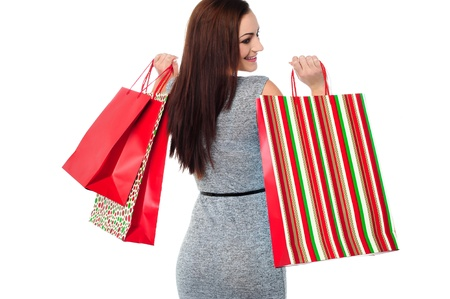Happy young smiling woman with vibrant shopping bags. photo