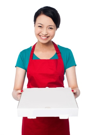 Young female chef delivering pizza photo
