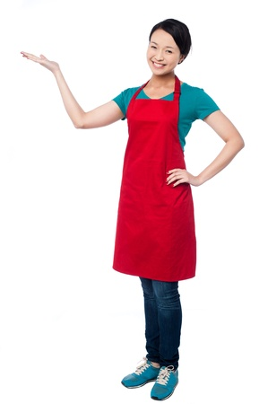 promoting: Cute female chef promoting bakery product Stock Photo
