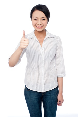yup: Beautiful smiling girl showing thumbs up gesture