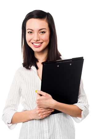 formals: Female executive in formals holding business files