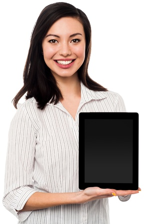 Saleswoman presenting newly launched tablet device for sale photo