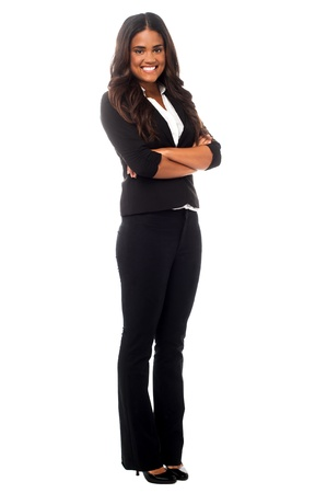 african american woman business: Smiling young business professional posing confidently in studio. Stock Photo