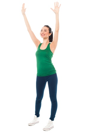 Smart young girl warming up her body before starting to exercise Stock Photo - 19860937