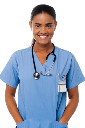 half  length: Half length image of a female doctor in uniform posing with hands in pocket