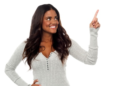 fingers on top: Charming smiling african woman pointing upwards