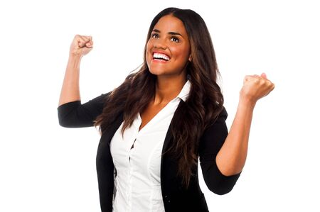 clenching fists: Businesswoman clenching her fists in excitement Stock Photo