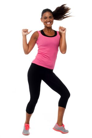 Excited fitness girl rejoicing and having fun photo