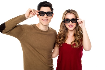sexual couple: Attractive young smiling couple adjusting their goggles