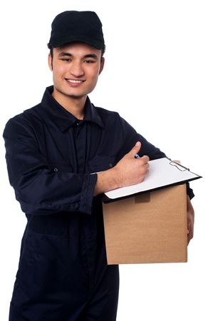 Young cheerful asian courier boy delivering you carton photo