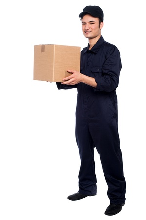 Young guy in uniform delivering parcel at your doorstep photo