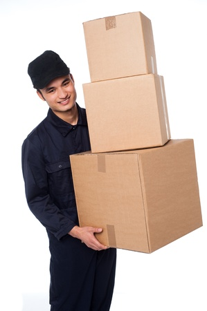 Young delivery boy holding stack of parcel boxes photo