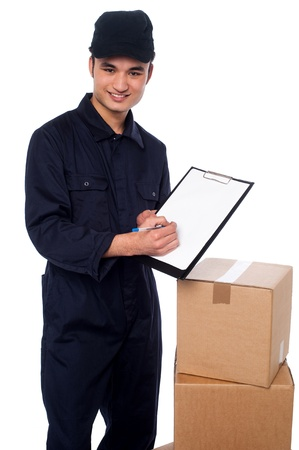 Young smart delivery man at work, isolated over white photo