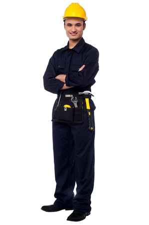 Confident young male worker posing with arms crossed photo