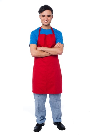 Full length studio shot of male chef posing with arms crossed photo