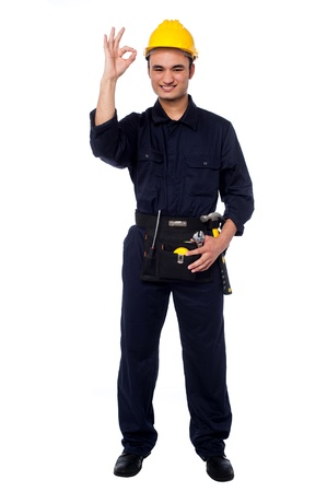 yup: Happy construction worker showing perfect gesture Stock Photo