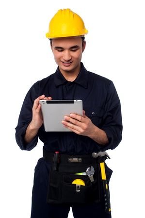 Young mechanical engineer accessing touch pad device photo