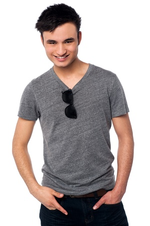 casuals: Studio shot of joyous young guy posing in trendy casuals Stock Photo